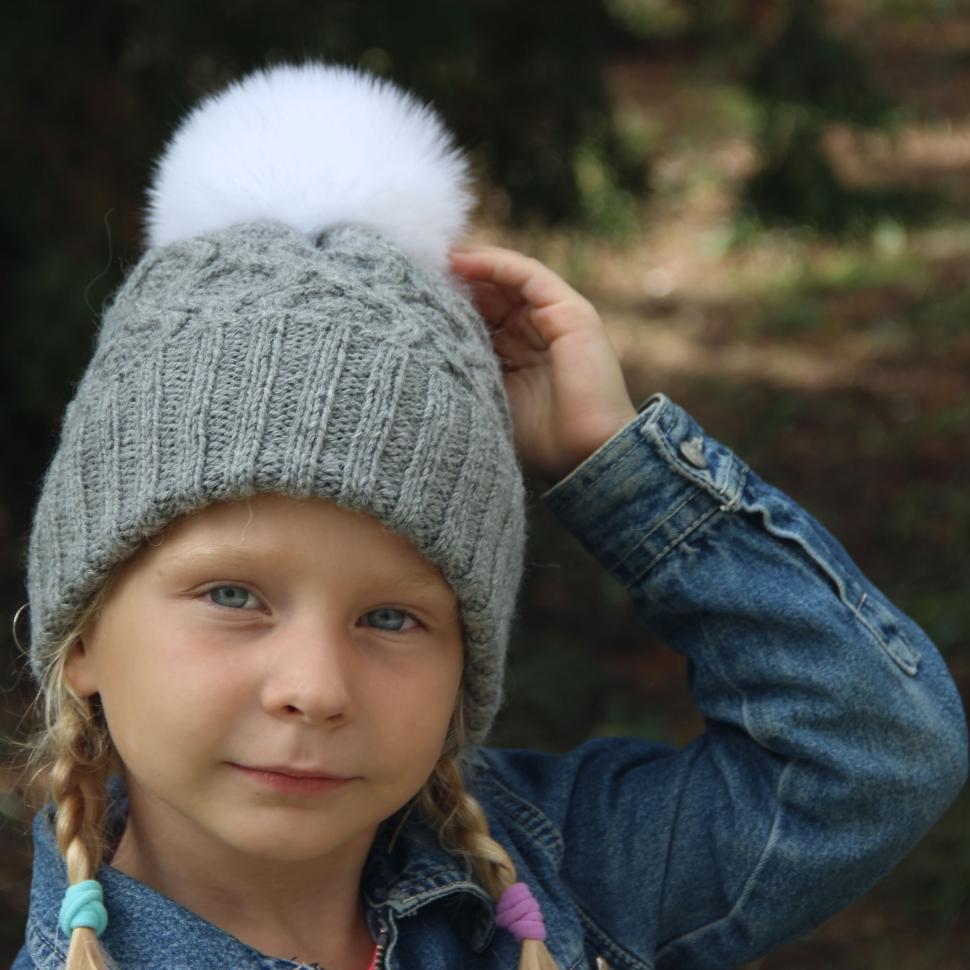 Преимущества детских вязаных шапок